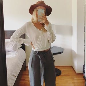 Cropped white long sleeve blouse
